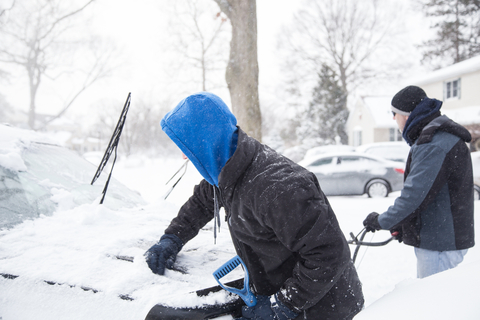 Teen helping shovel out car
